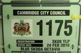 The green license plate on a private hire vehicle
